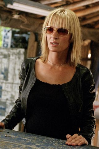 The Savvy Survivor: Uma Thurman in Kill Bill  The Beauty Mark: Despite having a to-do list that includes killing off all her former assassin associates, Thurman's The Bride takes the time to get a haircut in volume II of this epic sword-fighting series. When Bill is finally in her sights, she goes from tousled bedhead to sleek lob with blunt bangs.