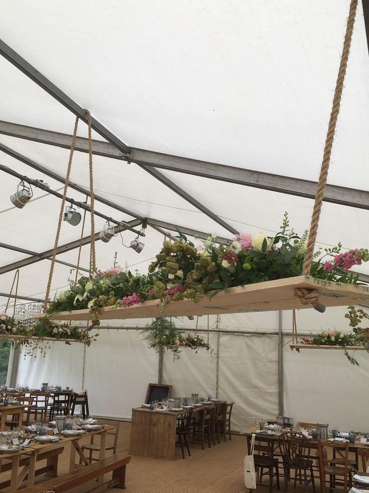 #wedding table centre pieces #swings #nettledenlodge