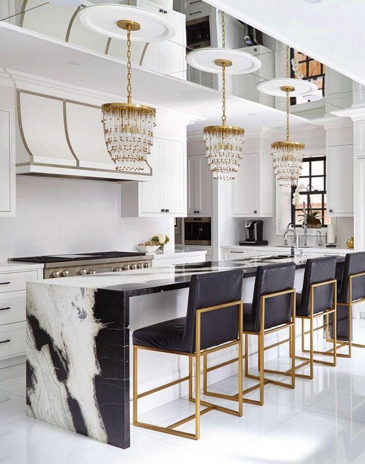 Glamorous white kitchen designed by interior designer bria