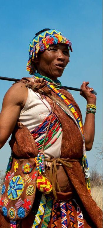 Collecting food is traditionally the work of women. San ...