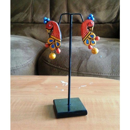 A pair of peacock  design terracotta earrings