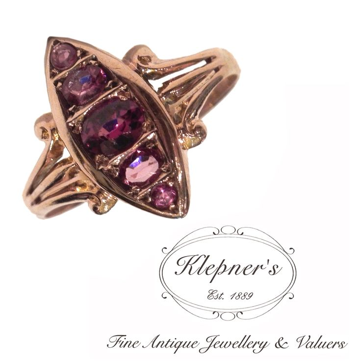 9ct rose gold antique marquise shaped garnet ring, grain set with five graduated rhodolite garnets. Hallmarked Chester 1909. Visit us at www.klepners.com.au
