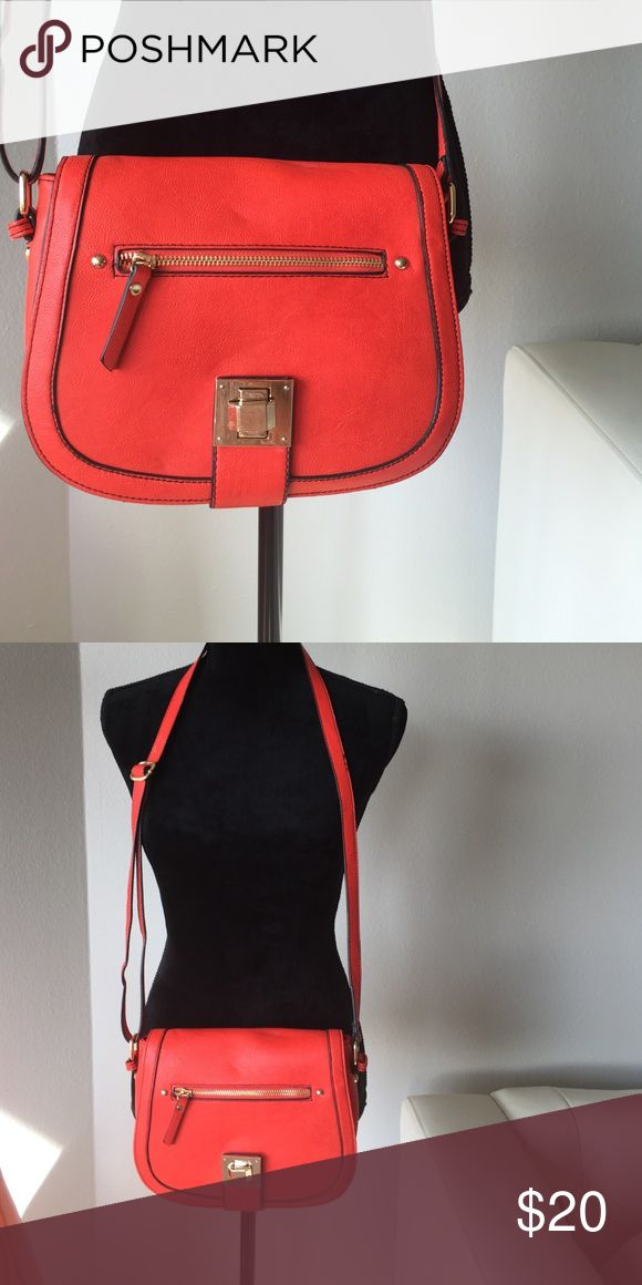 Red saddle bag Red crossbody saddle bag. Adjustable strap. Never used Oasis Bags Crossbody Bags