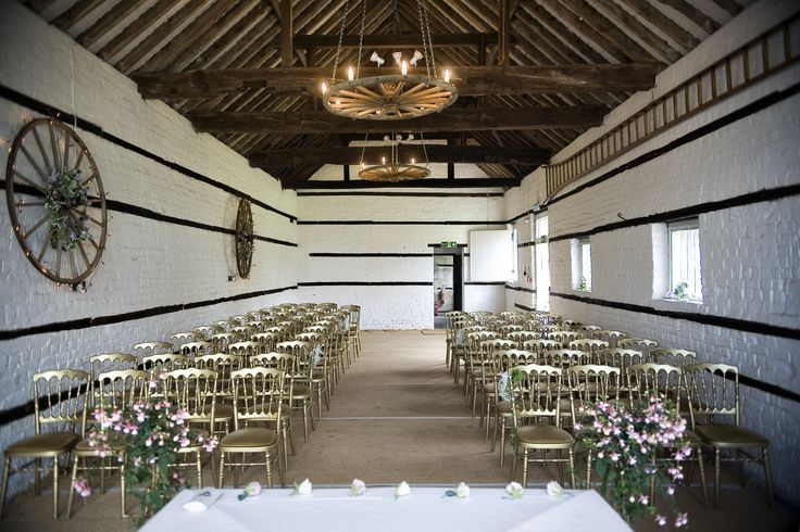 Lillibrooke Manor's small barn wedding venue for the ceremony with rustic decorations