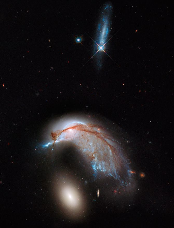 Interacting galaxy duo, Arp 142, shows the orbits of the galaxy's stars have become scrambled due to gravitational tidal interactions with the other galaxy.