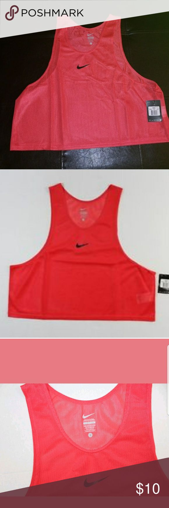 """Nike Scrimmage Vest Nike brand new with tags. Orange pullover.  Scrimmage vest with screen-printed Swoosh design trademark at center chest.  FABRIC: 100% polyester. One size fits most.  Pit-to-Pit 24.5""""  Length 20.75"""" Great for football and soccer scrimmage games or workouts. (Bin 19) Nike Shirts Tank Tops"""