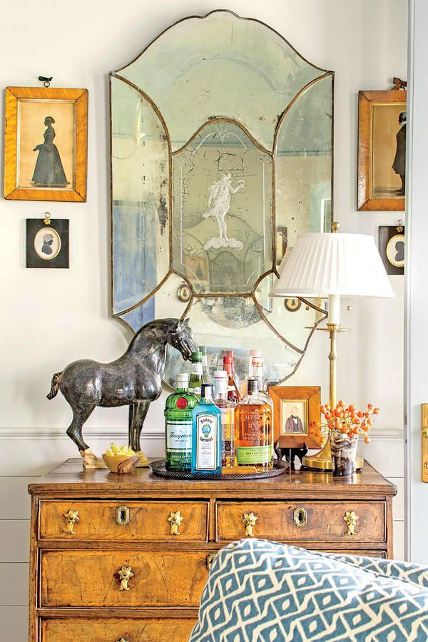 The Living Room - The Art of Living Small - Southernliving. Blount set up a bar atop this chest and stashed glasses in the drawers below.