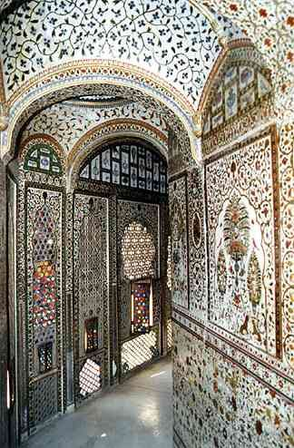 Sheesh Mahal is an interior room covered in thousands of tiny mirrors.  This room is in  Junagarh Fort, Bikaner, Rajasthan, India.