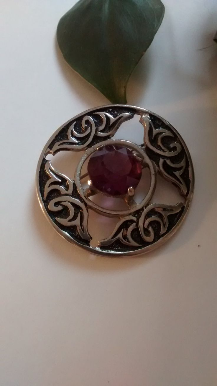 Scottish traditional Celtic knot and amethyst brooch by Puddledub on Etsy