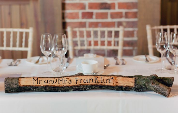 Personalised, engraved Tree Branch Top Table Decor - Image by Charli Photography - Lusan Mandongus Lace Dress for a rustic wedding in barn with musical theme and pastel colour scheme.
