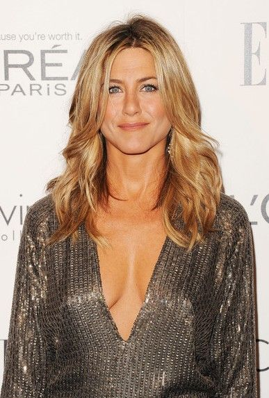 Jennifer Aniston- I saw her on Ellen the other day and it changed my whole view of her. She is elegant, classy and timeless. A real woman