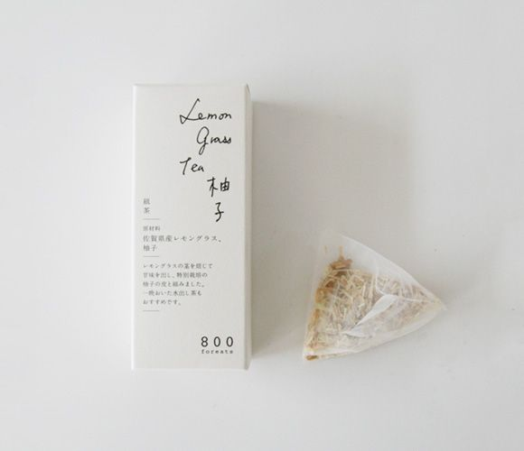 "Static typed text is set on a white background in the left bottom section of the packaging but the hand written words ""Japanese lemon grass tea"" at the top right create a sense of life and freedom with the flowing running writing. This makes the tea packaging look less clinical. Combing both typed text and hand generated text catches the viewer's attention."