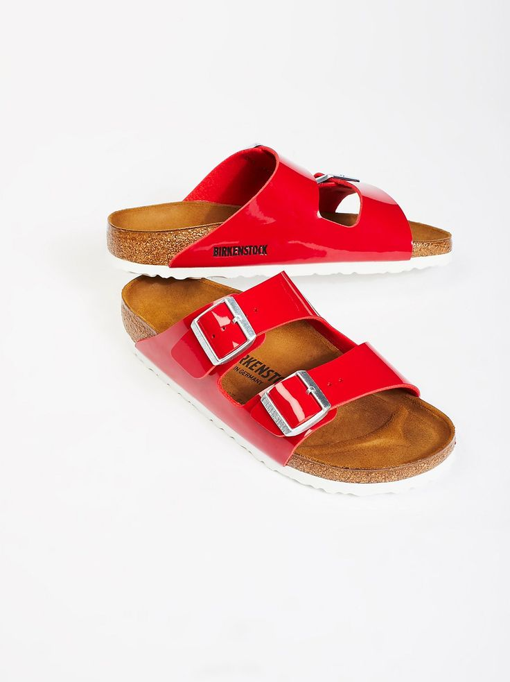 Arizona Patent Birkenstock | Classic Arizona Birkenstock silhouette featuring a patent upper and a comfortable, lightweight EVA sole. * Contoured footbed that supports the arches and molds to the foot * Adjustable straps