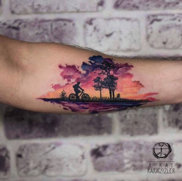 Beautiful sunset tattoo by Koray Karagozler