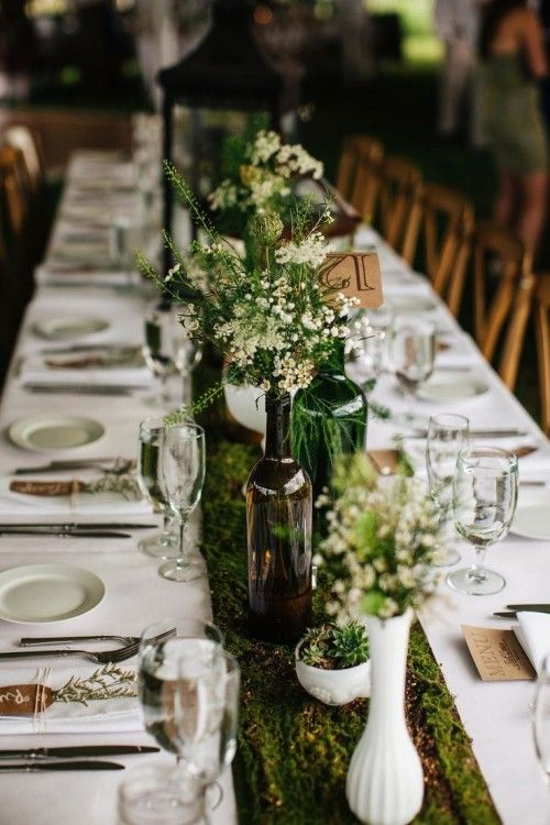 or this fresh clean white table cloth with a moss runner and then crazy pink florals