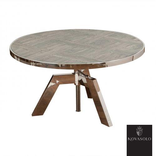 Råtøft Frost sofabord med justerbar høyde. Bordet er produsert i en kombinasjon av resirkulert, gråvasket alm og blankpolert rustfri stål!   Treverket er resirkulert som betyr at kvister, sprekker, skjevheter og andre mindre defekter er en bevisst og naturlig del av produktet - hvert enkelt møbel vil være helt unikt og ha sin egen sjarm! Fargevariasjoner vil forekomme innad på hvert møbel og fra produkt til produkt.