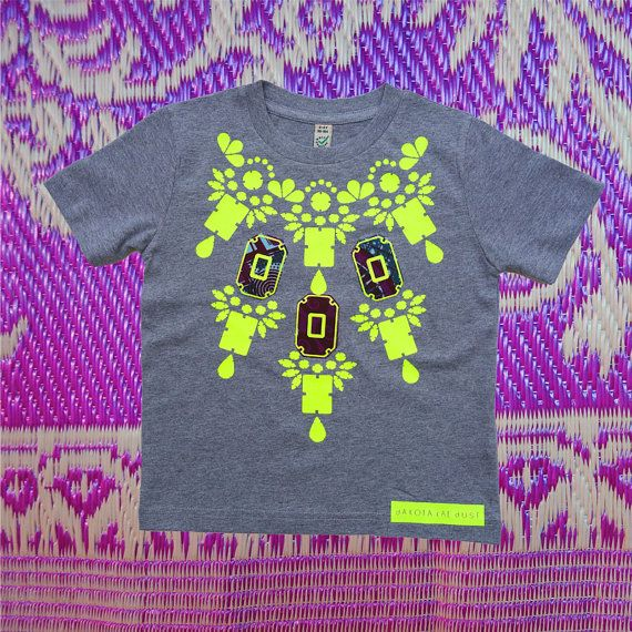 COLOURFUL Children's T-shirt with bold print in fluoro yellow vinyl and Ghanaian patterned fabric appliqué by dAKOTA rAE dUST
