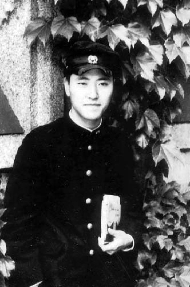 Kamikaze pilot Kiyoshi Ogawa during his school days in a school uniform holding a book.Ogawa along with his wingman (Seizō Yasunori) rammed the USS Bunker Hill which took it out of action for the rest of the war & killed nearly 400 American Sailors/aircrew. http://www.geocities.jp/kamikazes_site_e/ogawa_syoi.htm (Its all in English don't worry)