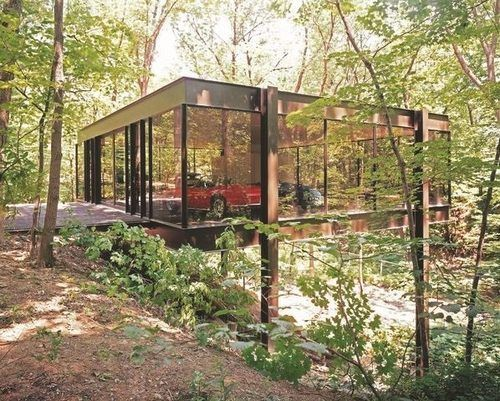 Ferris Bueller's House! This modernist Highland Park home has glass walls, exposed steel structure, four interior parking spots and is lifted on stilts above its forest surroundings.