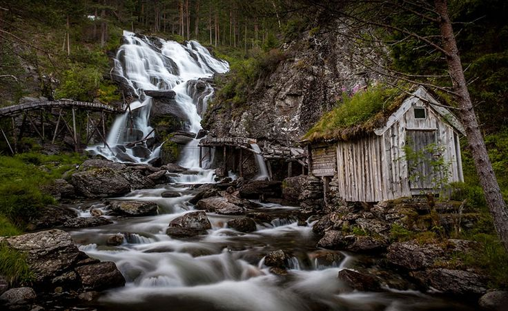 Former mill at Kvednafossen Waterfall in Norway. Kvednafossen is in Oppland, Norway, between Kvednehaugadn and Røyneslie