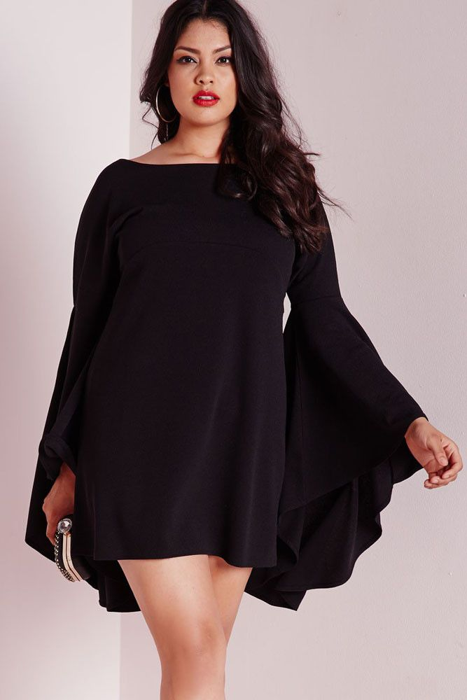This always on trend black swing dress is so hot right now and is a total wardrobe lust have. Get your flare on with the off the hook flared sleeve details. Be inspired and up your style game and enha