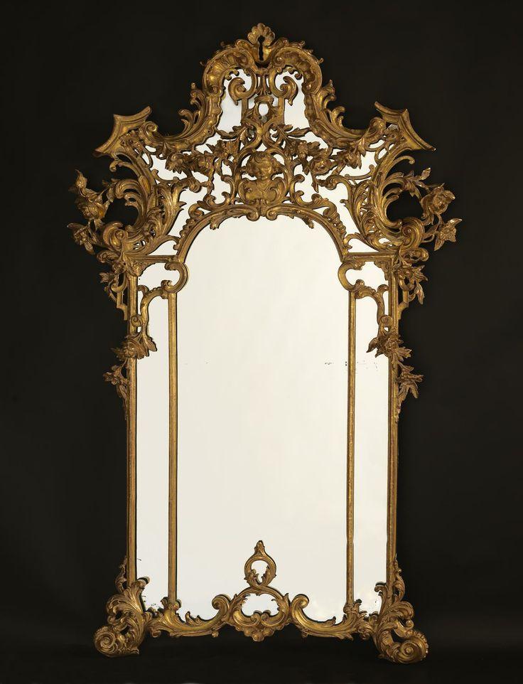 *A Fine and Ornate Rococo Style Giltwood Mirror.  Italian, Circa 1890.