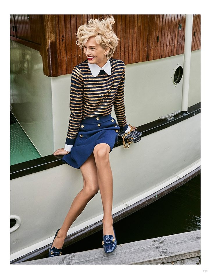 Sitting on a dock, Romee Strijd models Michael Kors Collection striped top, embellished skirt and loafers  for Vogue Magazine Japan January 2017 issue