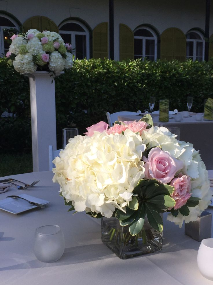 White hydrangea pink rose centerpiece and pedestal