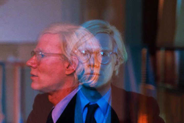 "Thomas Hoepker, New York City. Manhattan. 1981. Double exposure of Andy Warhol in his ""Factory"" at Union Square."