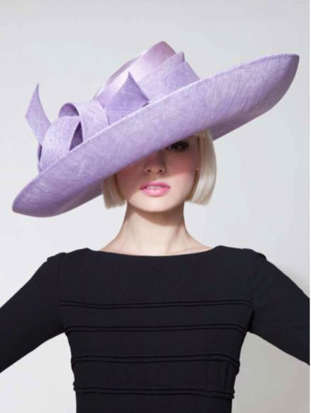 She's beautiful in lavender hat.