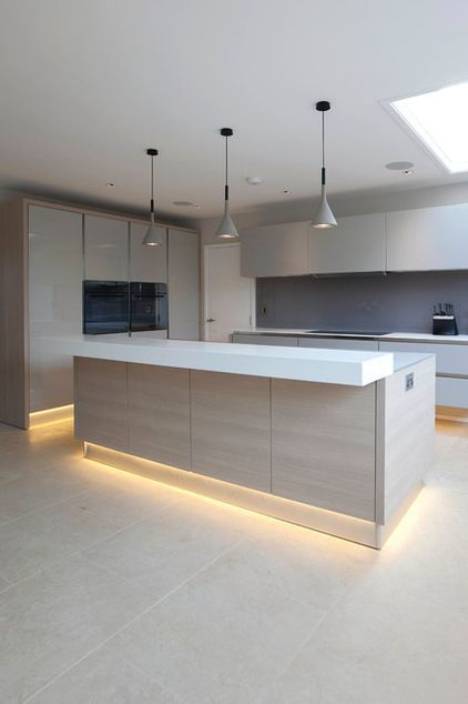 Contemporary Kitchen by Cucucine Home & Kitchen Living   The low-level lighting provides a warm glow.
