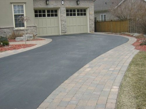 Wide interlock border on asphalt driveway from Earthworks Landscaping