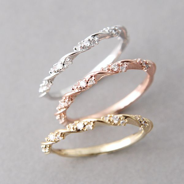 Stackable wedding rings in rose gold, yellow gold, and white gold. See the post at http://tulleandtwine.com/2013/10/8/trend-worth-trying-stackable-wedding-bands