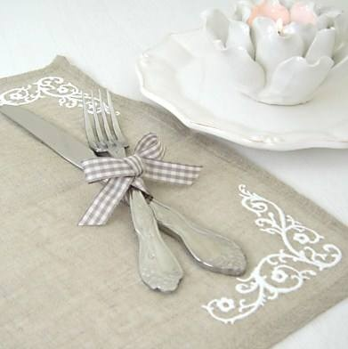 linen and white placemats pretty table setting