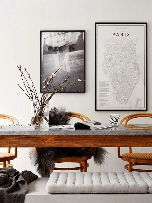 Black and white art, wooden furniture.
