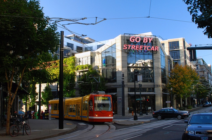 portland, or: streetcar with neon sign