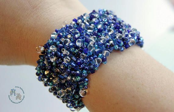 Fashion Jewellery Trendy Beaded handmade bracelet, a wide multicolor bracelet with great number and variety of beads and crystals, with a tender heart-shaped hook and a chain to variate the length of a bracelet A wonderful and unforgettable piece to wear for special occasions,