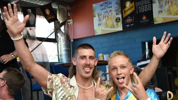 People show off their mullet haircuts at Mulletfest 2018 in the town of Kurri Kurri, 150km north of Sydney on February 24, 2018. Photo: AFP