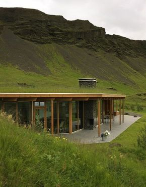 An amazing mountainside grass roof home with a well-designed contemporary interior. Beautiful Home Is Energy Efficient And Blends With The Hillside | Tiny Homes