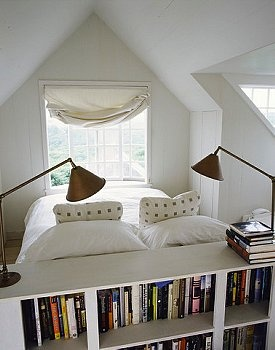 Interesting arrangement for a small attic space. I link the idea of facing the bed out of the window.
