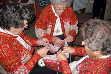The traditional way of knitting the Finnish renowned fisherman's, the Korsnäs sweater. Three ladies doing the middle part at the same time while in the past the male master did the tapestry crocheted parts.