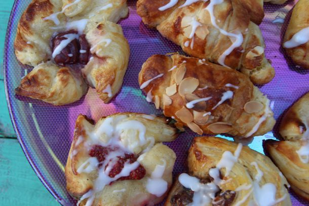 Danish pastries, layer upon layer of flaky dough. Filled with custard or almond cream, jam or fruit, delish. For how to, see the blog post.
