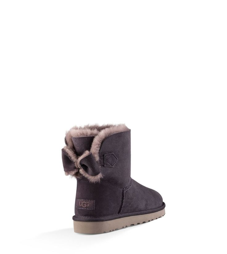When in doubt, go with the bow. Featuring plush sheepskin and natural wool, this sweet style is finished with our Treadlite by UGG™ sole for exceptional traction and cushioning.