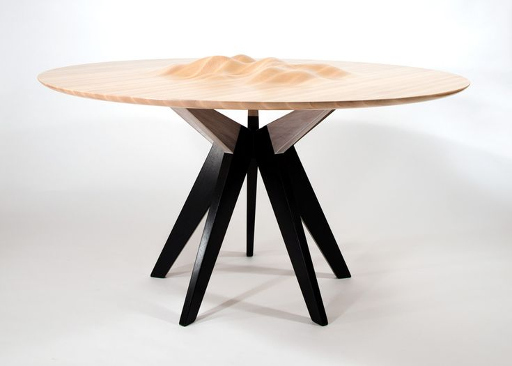 The Ocean's Edge table, a dining table created by American designer Tyson Atwell who finds inspiration from the movement of the tides of the San Francisco Bay.,