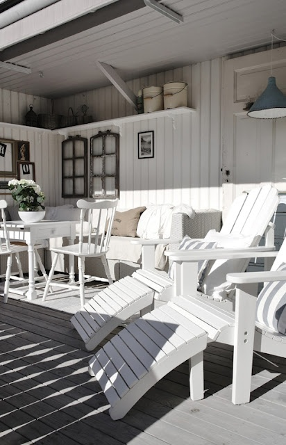 white adirondack chairs and lots of other seating choices for entertaining
