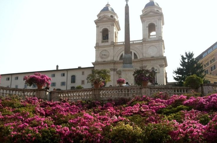 The Spanish Steps in bloom with azalea flowers.If you book an accommodation within this area, you will live an unforgettable experience in Rome in the springtime.