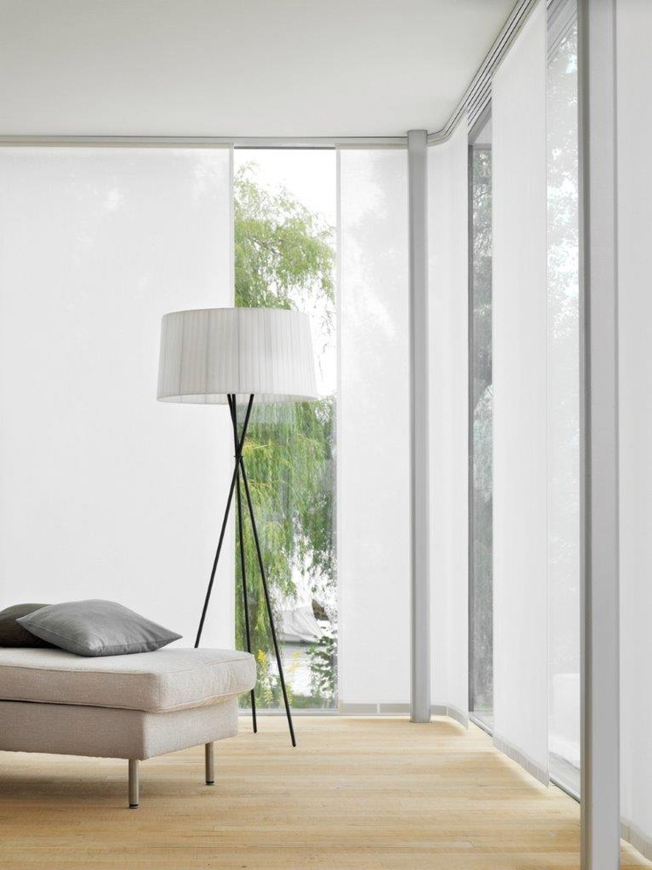 Panel Glide blinds extending around the corner