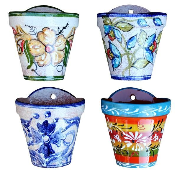 Wall Hanging Flower Pot (Spanish Rainbow) - Hand Painted in Spain – Cactus Canyon Ceramics. The Spanish Wall Pot is a practical design that is a beautiful adornment on the patio or in the house.  Hand painted in Andalusia, Spain Terracotta pot with a hand painted, glazed finish