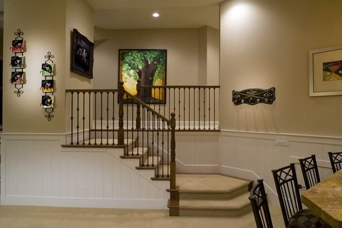 Transitional Basement with white painted wainscoting #designmine