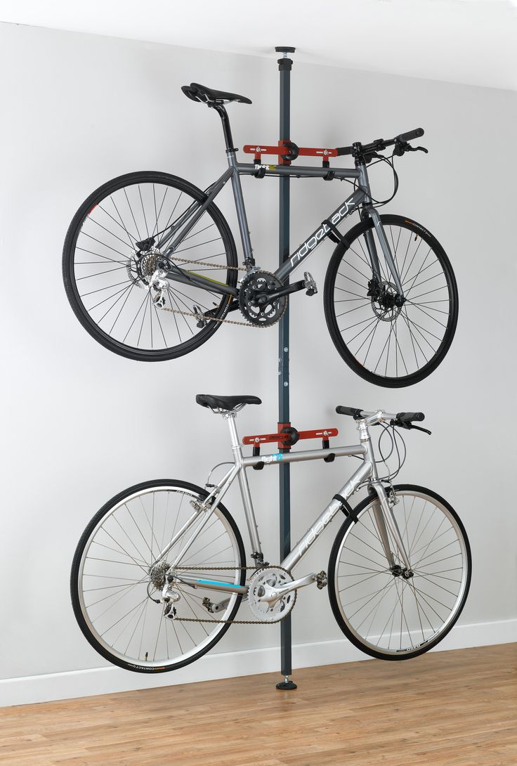 Features:  -Tension mounted design to hold 2 bikes.  -Storage arms adjust independently over a 7' area to fit almost any style of bike.  -Top and extender adjusts to accommodate ceiling heights from 8